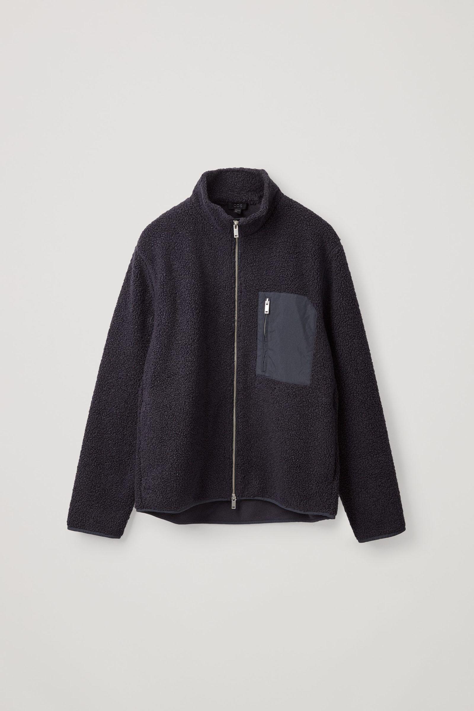 COS 테디 집업 재킷의 네이비컬러 Product입니다.