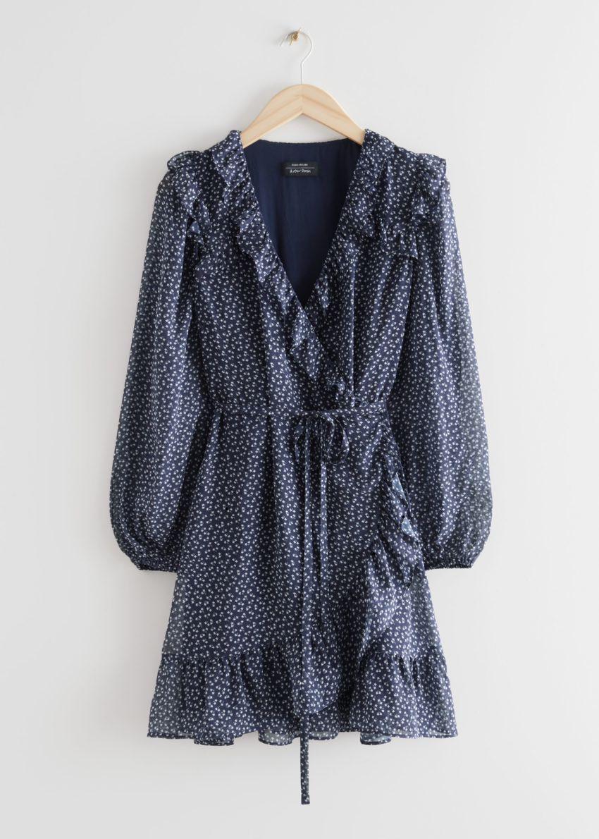 앤아더스토리즈 러플 미니 랩 드레스의 블루 프린트컬러 Product입니다.