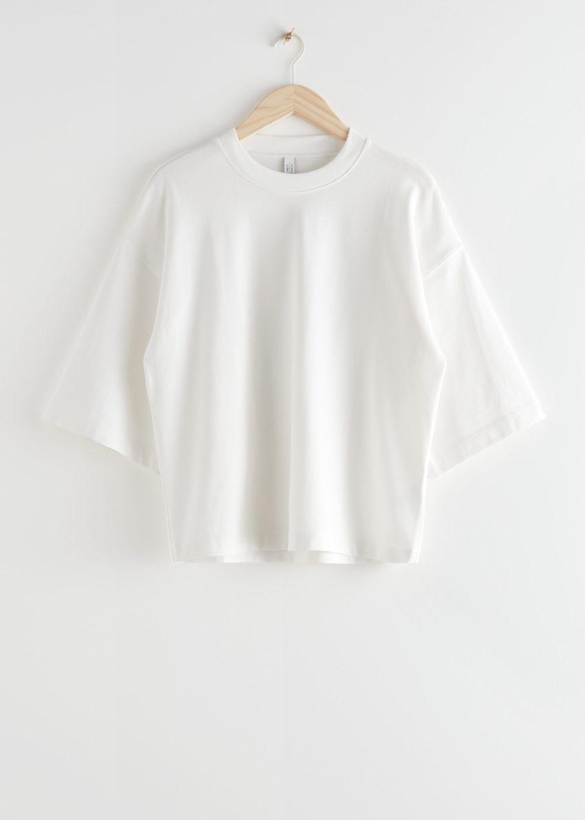 앤아더스토리즈 박시 크루넥 티셔츠의 화이트컬러 Product입니다.