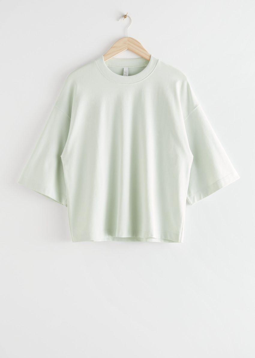 앤아더스토리즈 박시 크루넥 티셔츠의 라이트 그레이컬러 Product입니다.