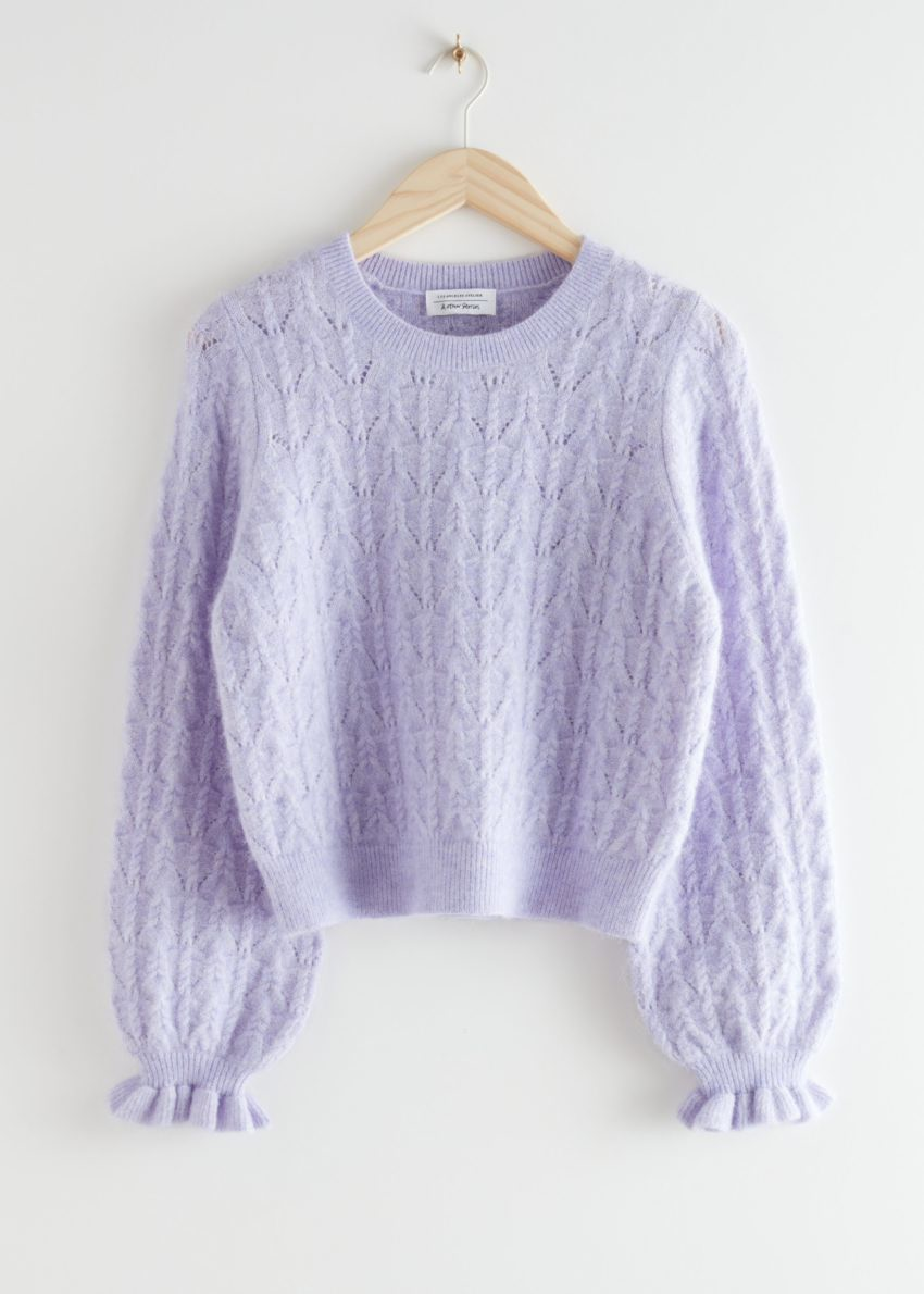 앤아더스토리즈 알파카 블렌드 러플 케이블 니트 스웨터의 라일락컬러 Product입니다.