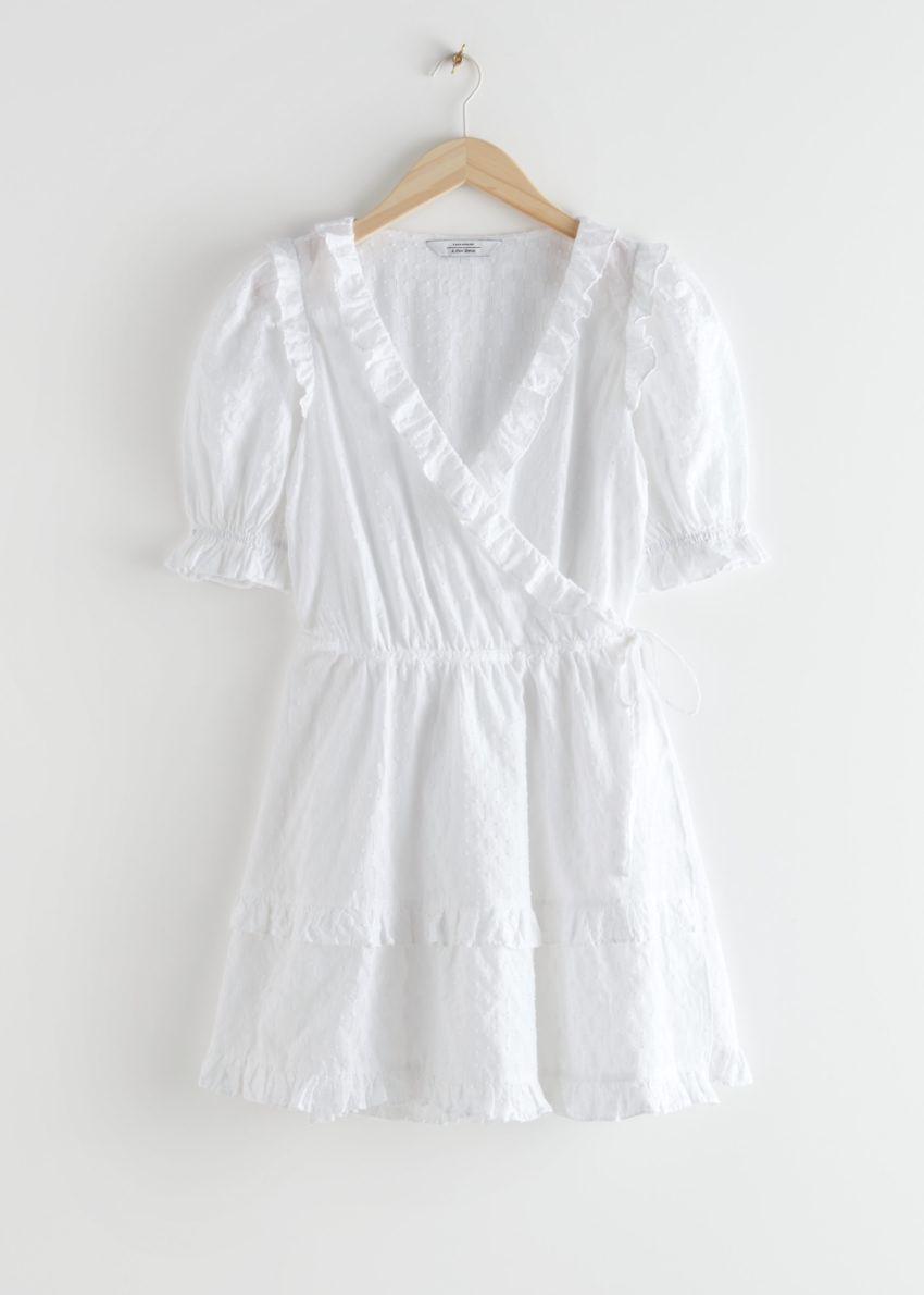 앤아더스토리즈 프릴 엠브로이더리 미니 드레스의 화이트컬러 Product입니다.