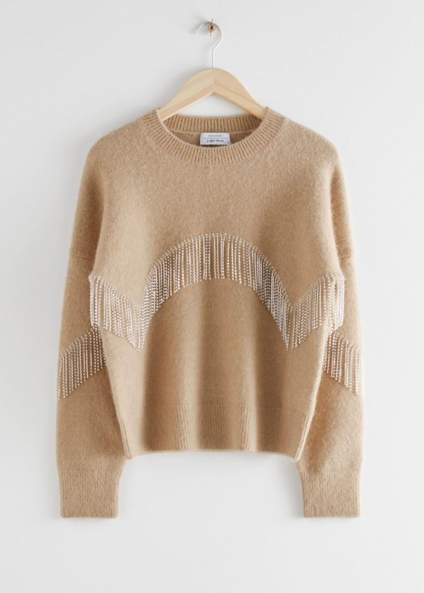 앤아더스토리즈 디아망테 프린지 스웨터의 베이지컬러 Product입니다.