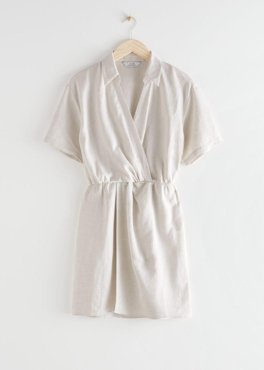 앤아더스토리즈 트위스트 웨이스트 트윌 미니 드레스의 화이트컬러 Product입니다.