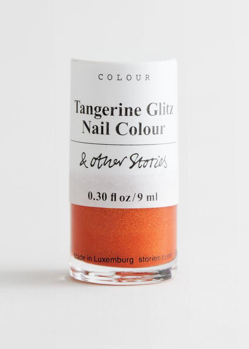 앤아더스토리즈 선플라워 매직 네일 컬러의 탠저린 글리츠컬러 Product입니다.