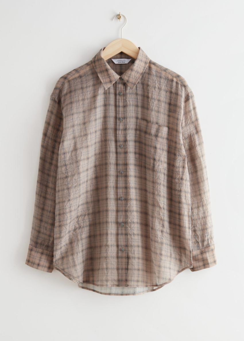 앤아더스토리즈 오버사이즈 버튼 업 셔츠의 베이지 체크컬러 Product입니다.