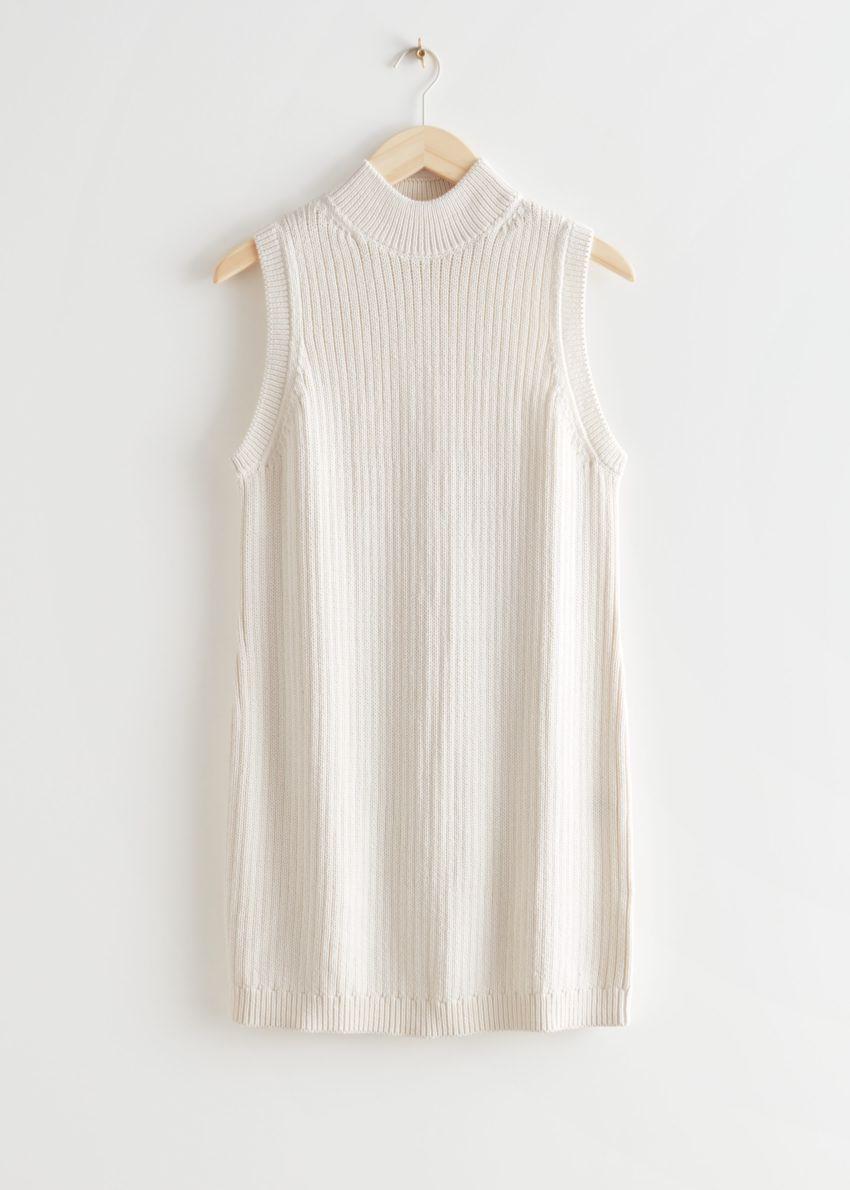 앤아더스토리즈 모크 넥 니트 미니 드레스의 화이트컬러 Product입니다.