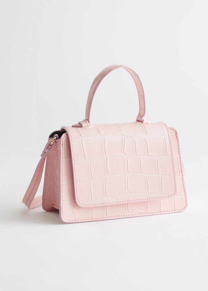 앤아더스토리즈 크로크 엠보스드 미니 레더 백의 라이트 핑크컬러 Product입니다.