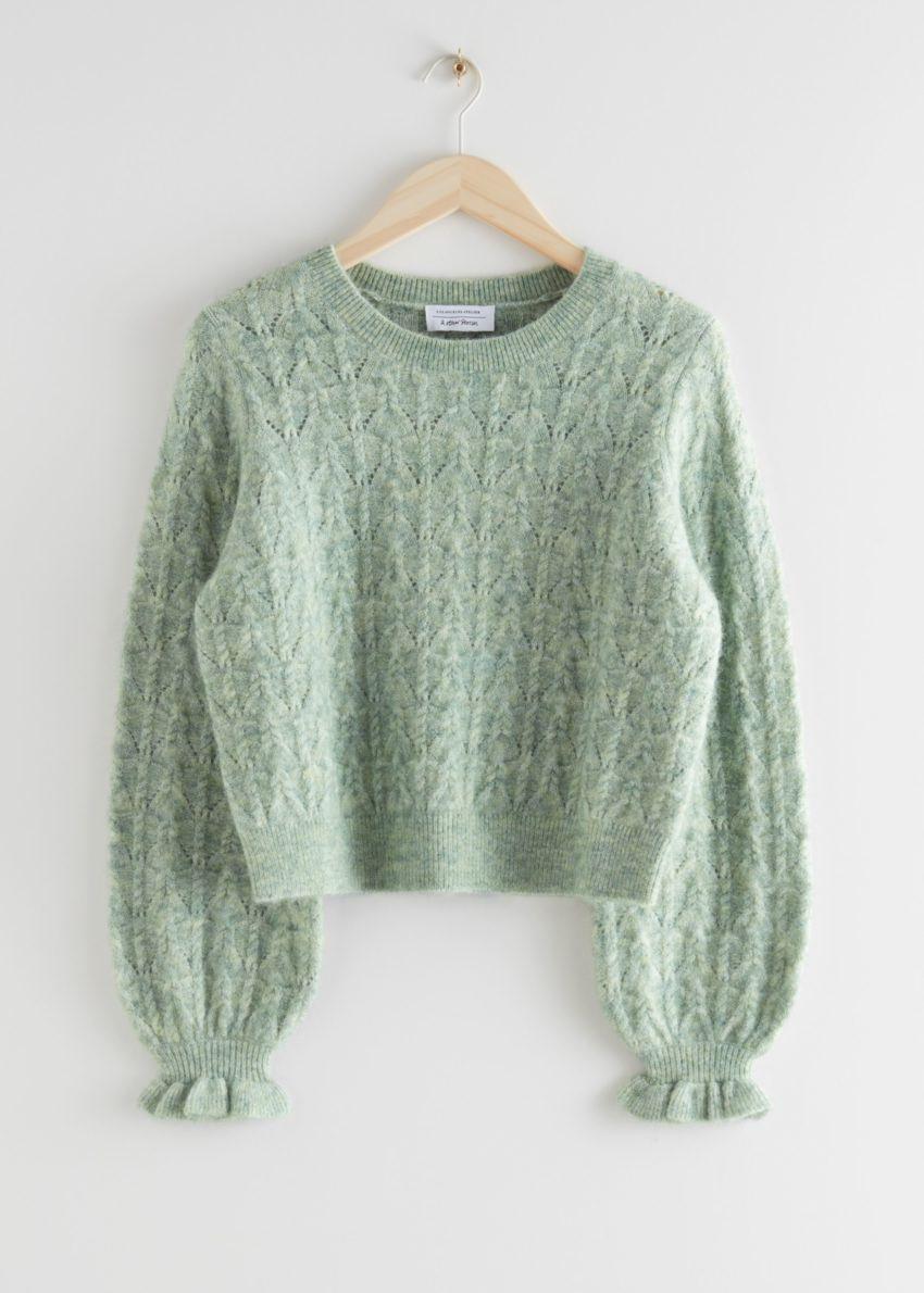 앤아더스토리즈 알파카 블렌드 러플 케이블 니트 스웨터의 라이트 그린컬러 Product입니다.