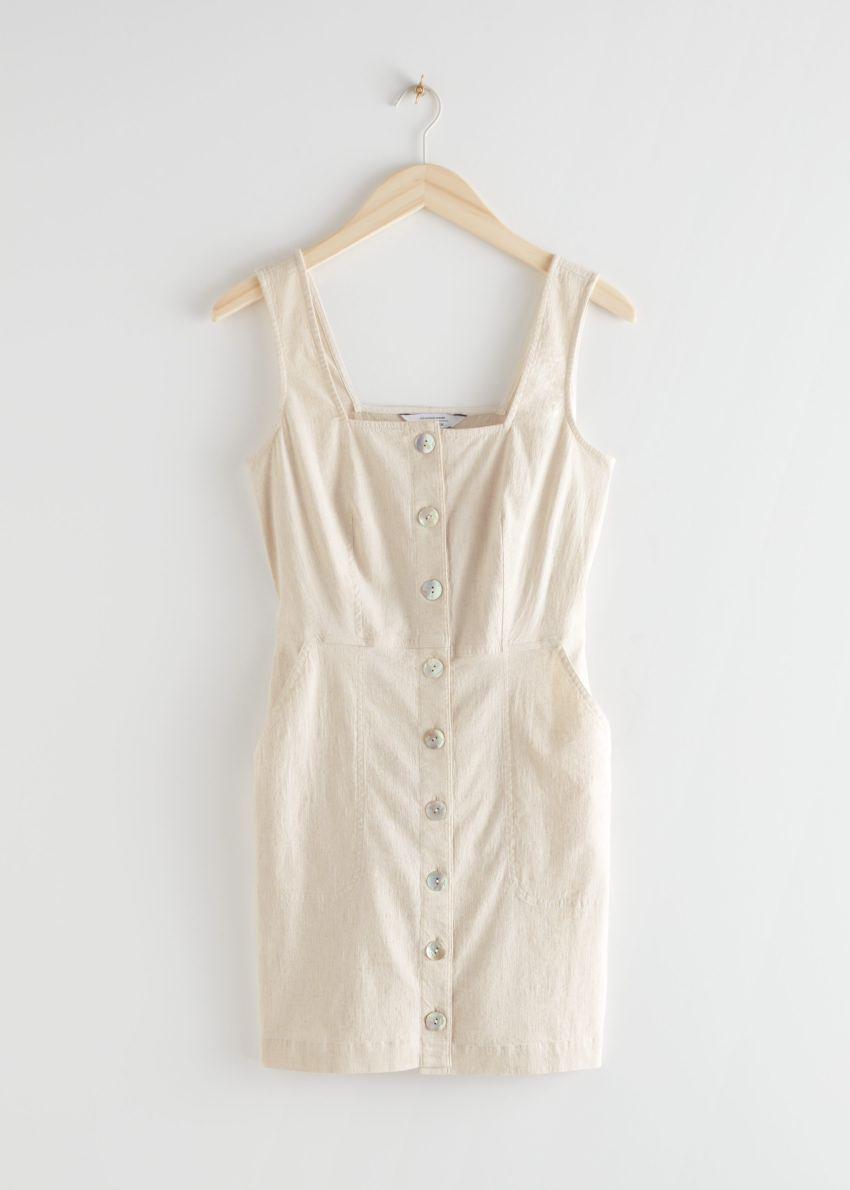 앤아더스토리즈 슬리브리스 피티드 버튼 다운 미니 드레스의 화이트컬러 Product입니다.