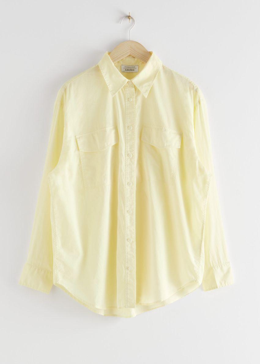 앤아더스토리즈 오버사이즈 버튼 업 셔츠의 옐로우컬러 Product입니다.