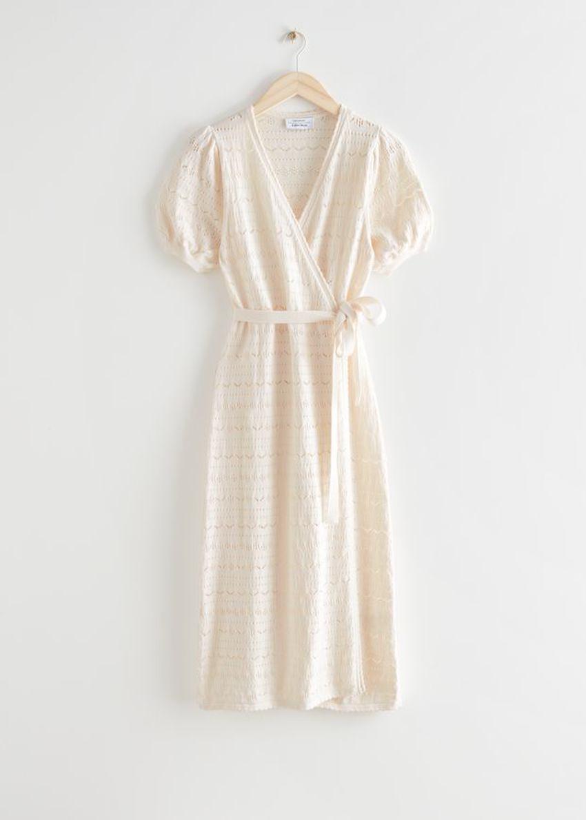 앤아더스토리즈 포인텔 니트 미디 랩 드레스의 크림컬러 Product입니다.