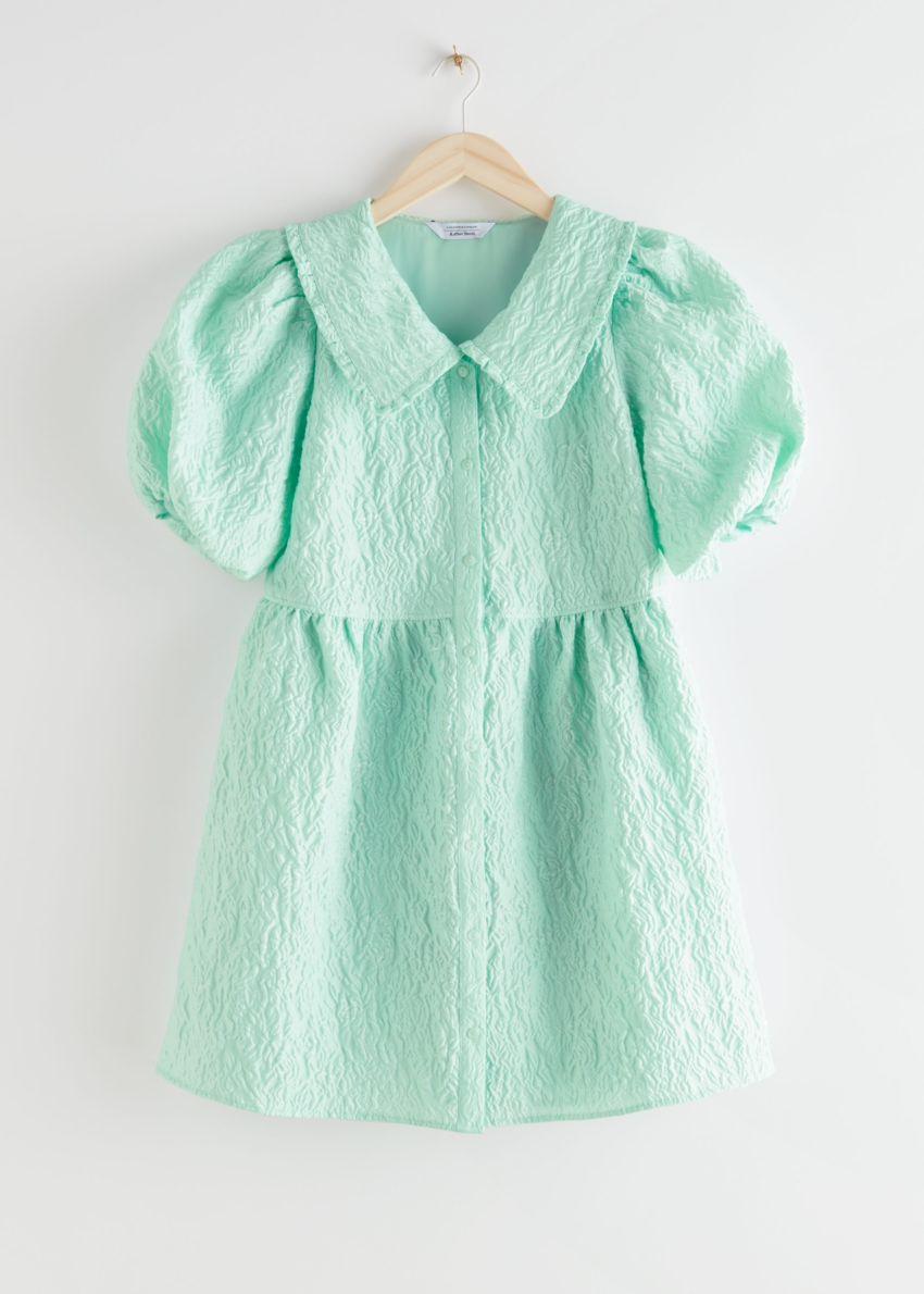 앤아더스토리즈 버튼 퍼프 슬리브 자카드 미니 드레스의 민트컬러 Product입니다.