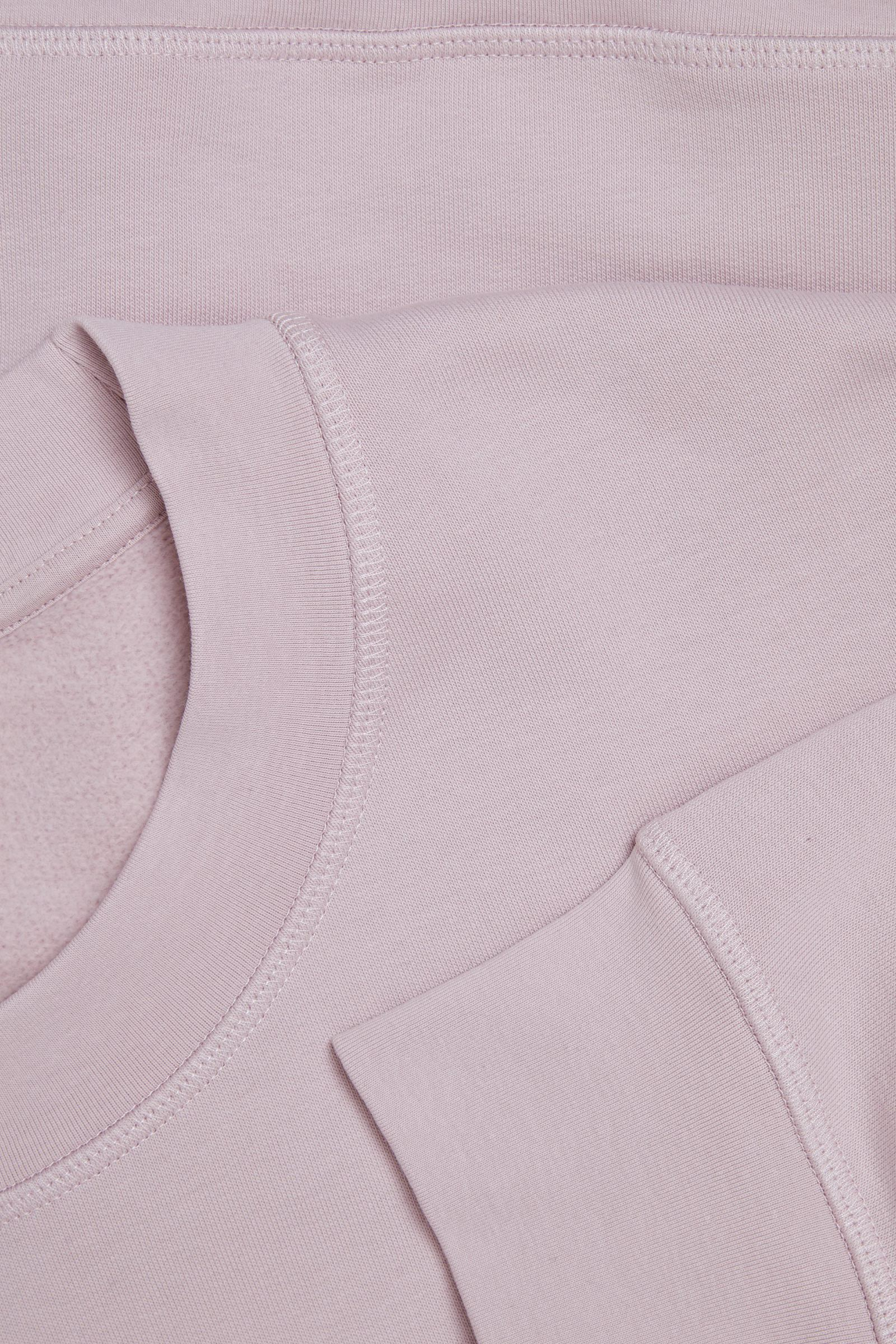 COS 코튼 릴랙스드 스웻셔츠의 핑크컬러 Detail입니다.