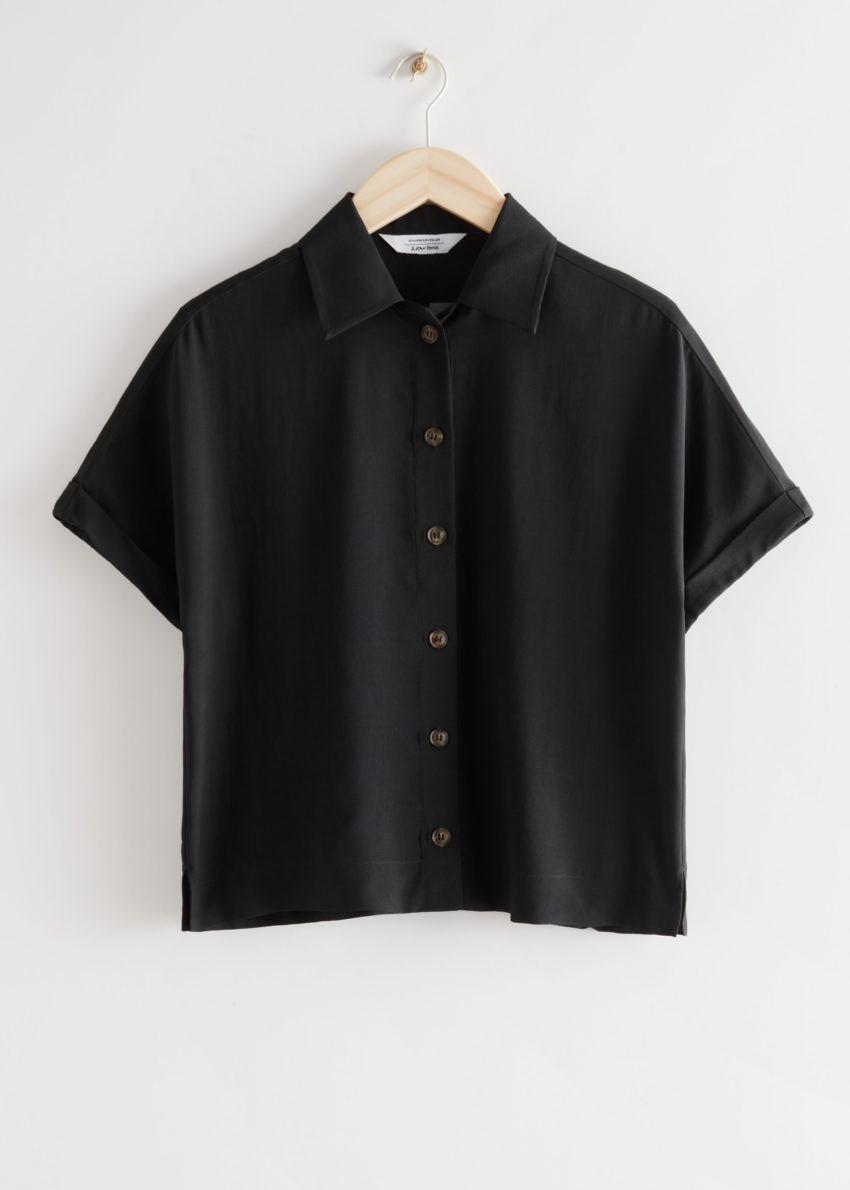 앤아더스토리즈 박시 버튼 업 셔츠의 블랙컬러 Product입니다.