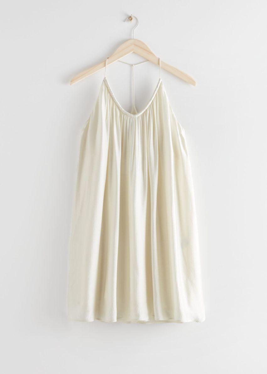 앤아더스토리즈 볼류미너스 스파게티 스트랩 미니 드레스의 크림컬러 Product입니다.