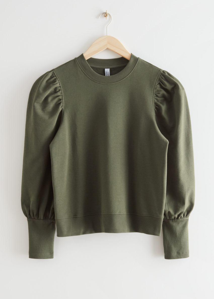 앤아더스토리즈 퍼프 슬리브 코튼 스웨터의 카키컬러 Product입니다.