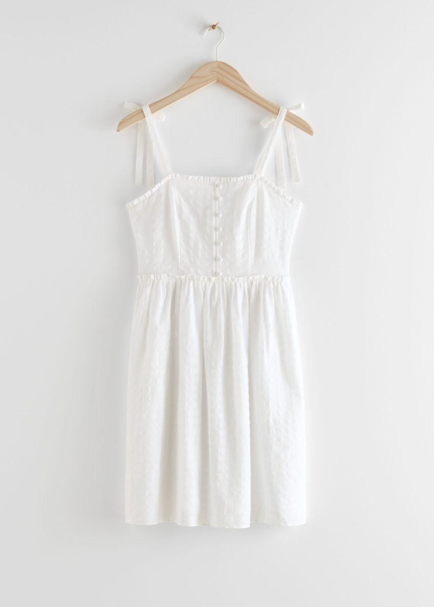 앤아더스토리즈 스모크 스트랩 미니 드레스의 화이트컬러 Product입니다.