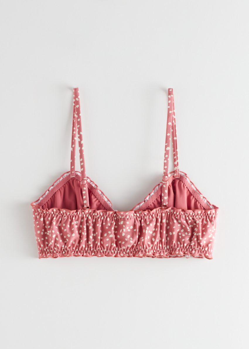 앤아더스토리즈 러플 트림 도트 비키니 탑의 핑크 도트컬러 Product입니다.