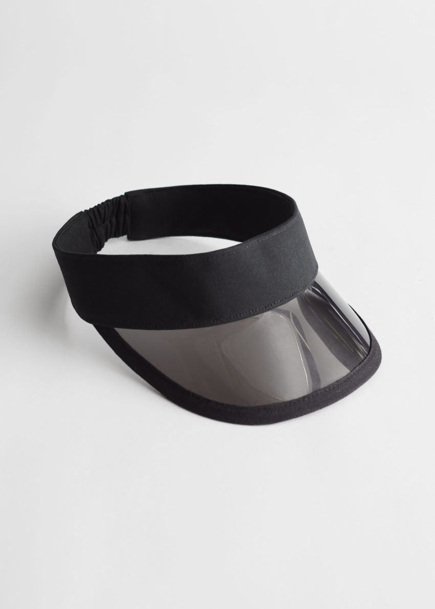 앤아더스토리즈 클리어 브림 썬 바이저의 블랙컬러 Product입니다.