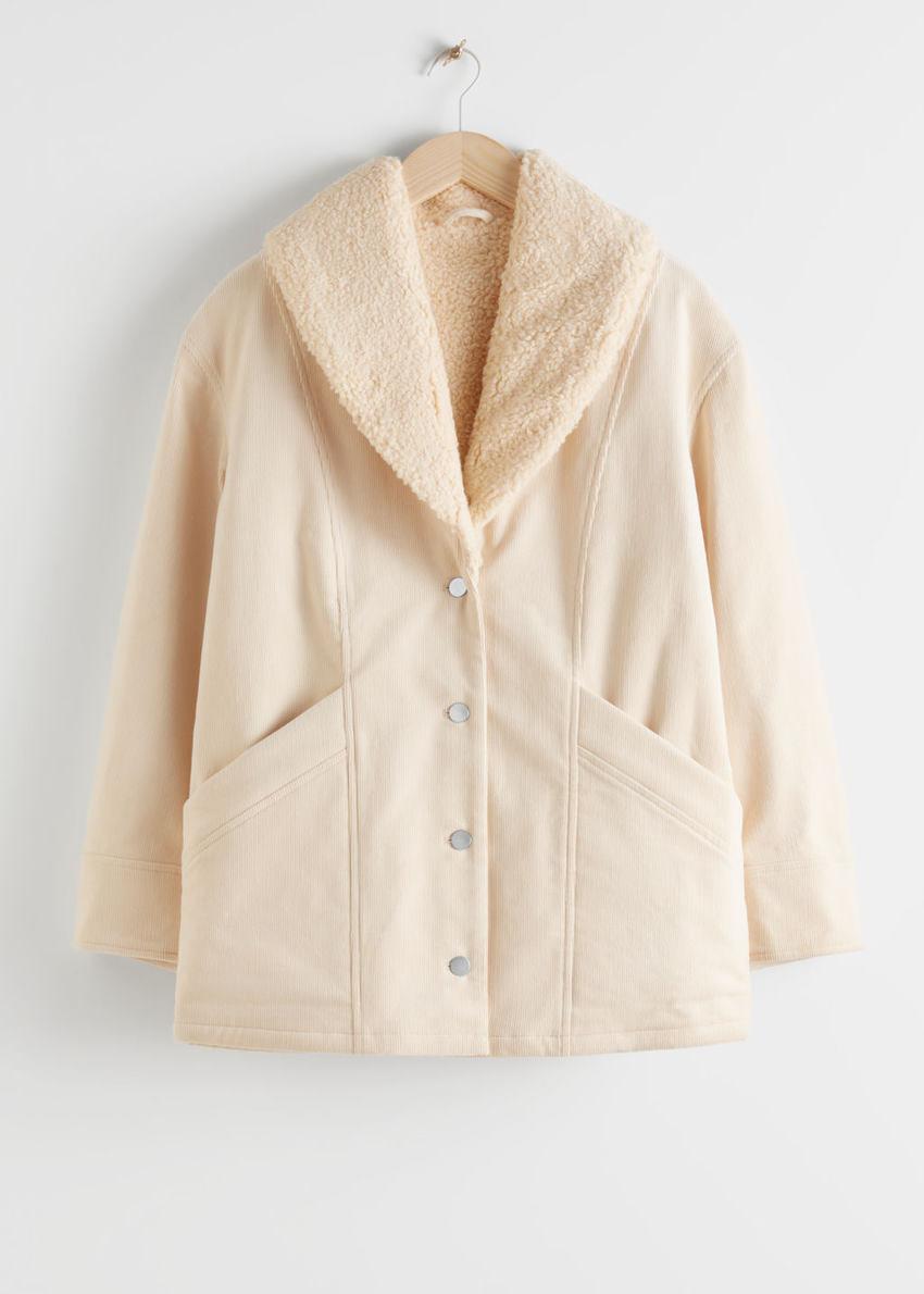 앤아더스토리즈 코튼 블렌드 셜링 카라 코트의 베이지컬러 Product입니다.