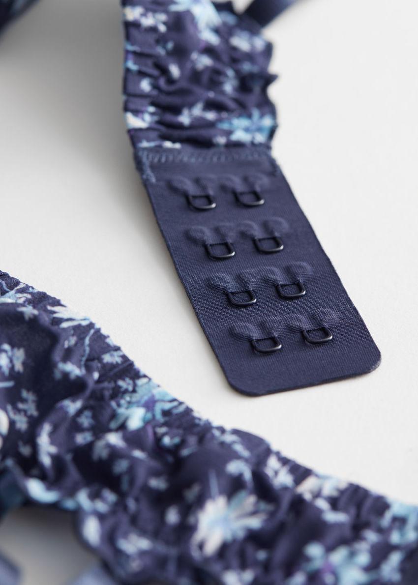 앤아더스토리즈 러플 플로럴 패디드 브라의 블루 플로럴컬러 Product입니다.