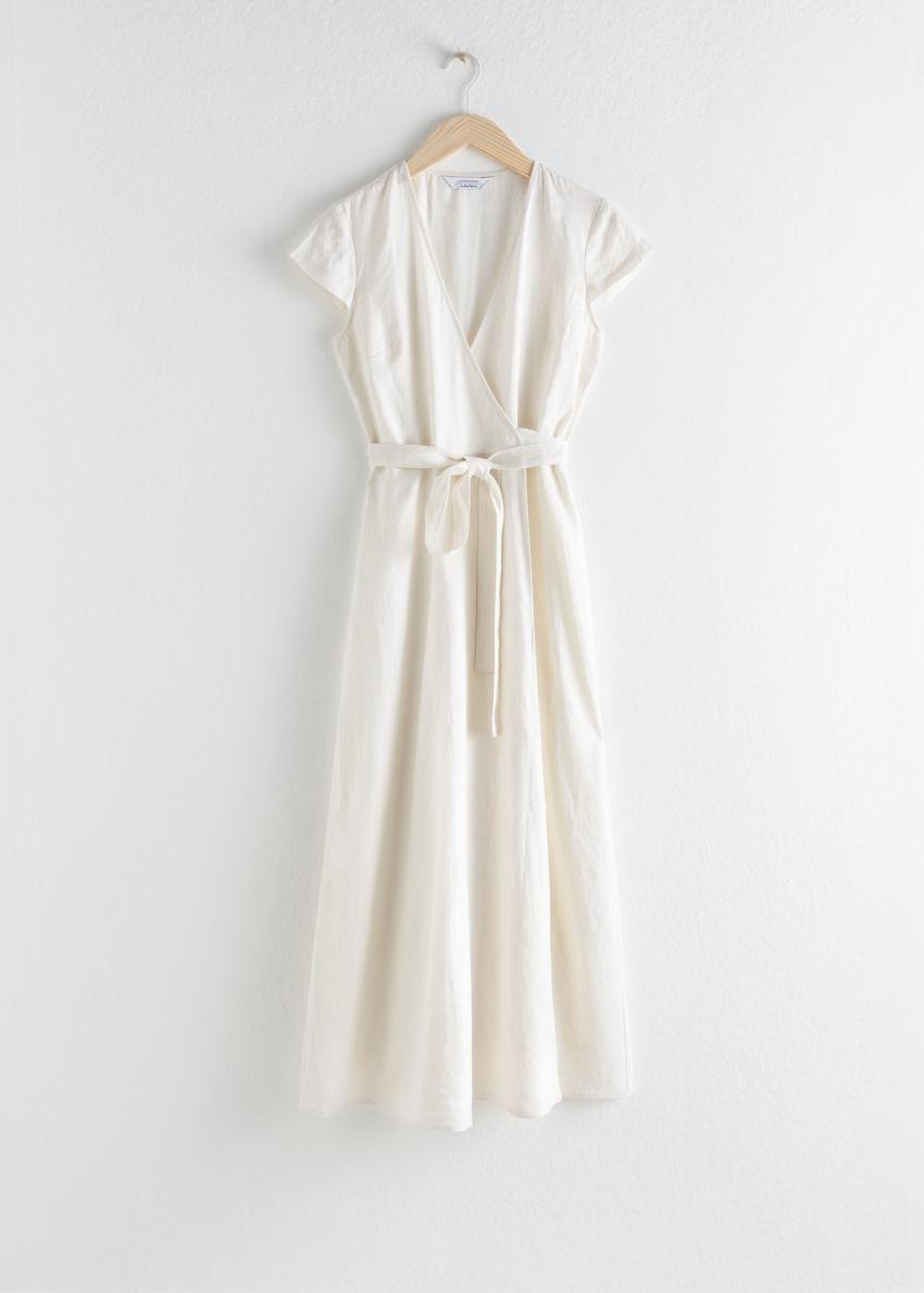 앤아더스토리즈 깅엄 리넨 미디 랩 드레스의 화이트컬러 Product입니다.