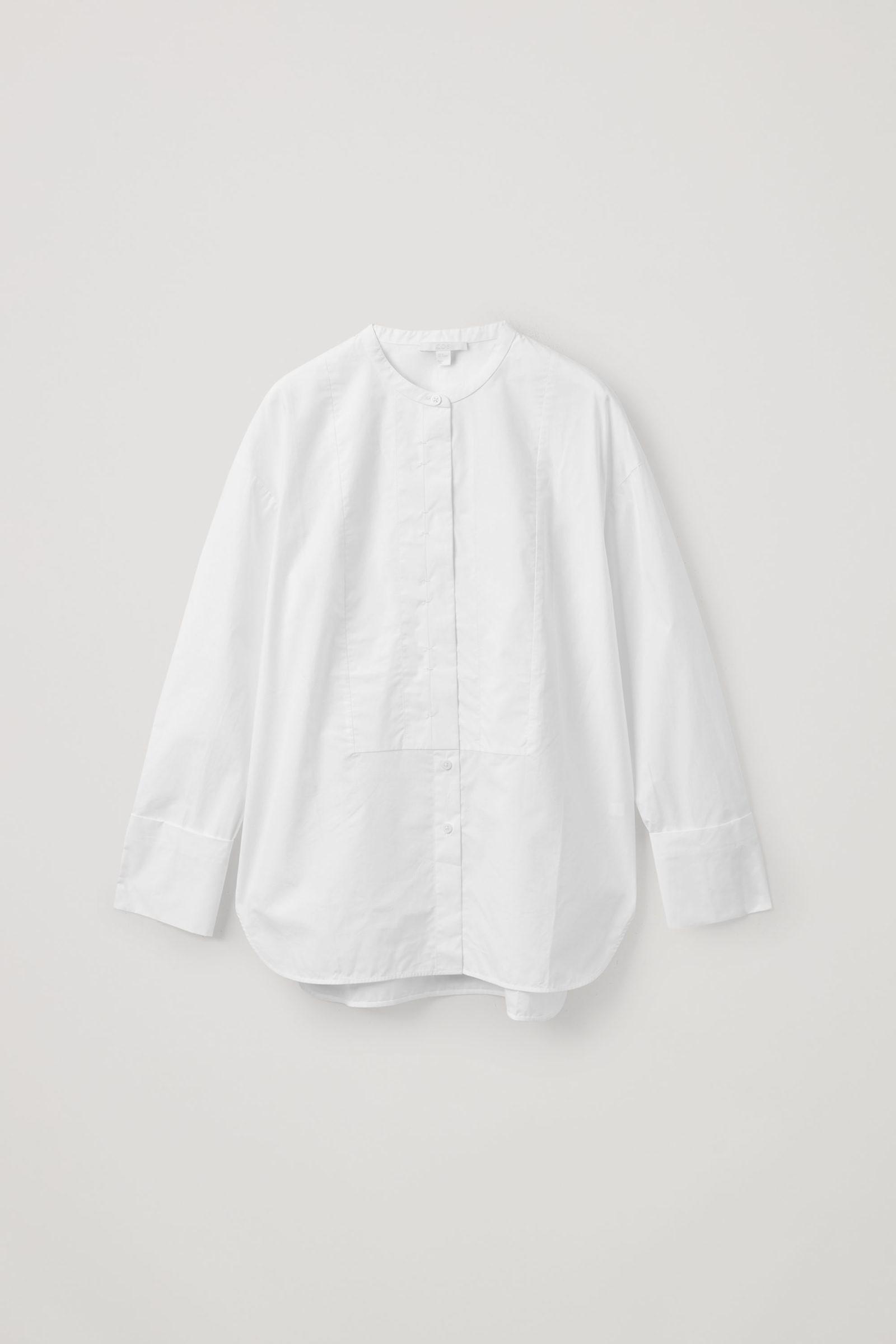 COS 코튼 빕 인서트 튜닉 스타일 셔츠의 화이트컬러 Product입니다.