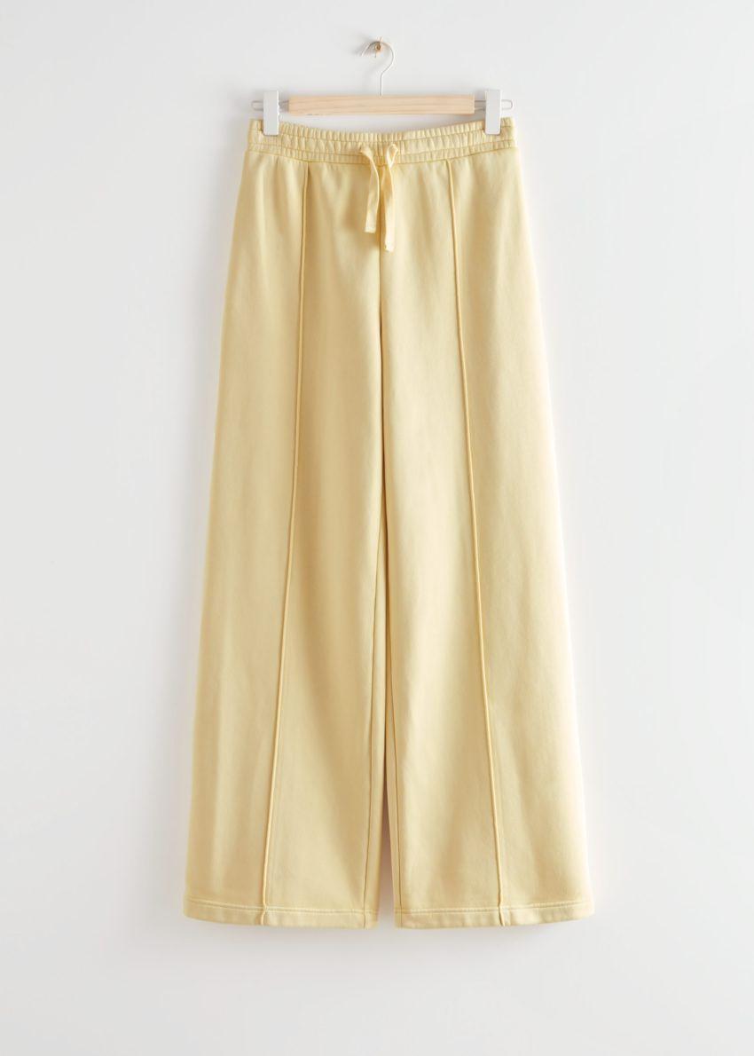 앤아더스토리즈 와이드 엘라스티케이트 웨이스트 트라우저의 라이트 옐로우컬러 Product입니다.