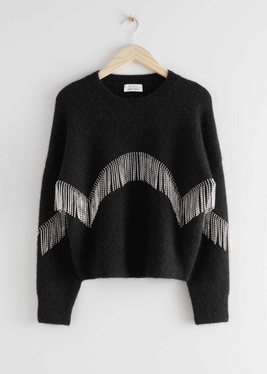 앤아더스토리즈 디아망테 프린지 스웨터의 블랙컬러 Product입니다.