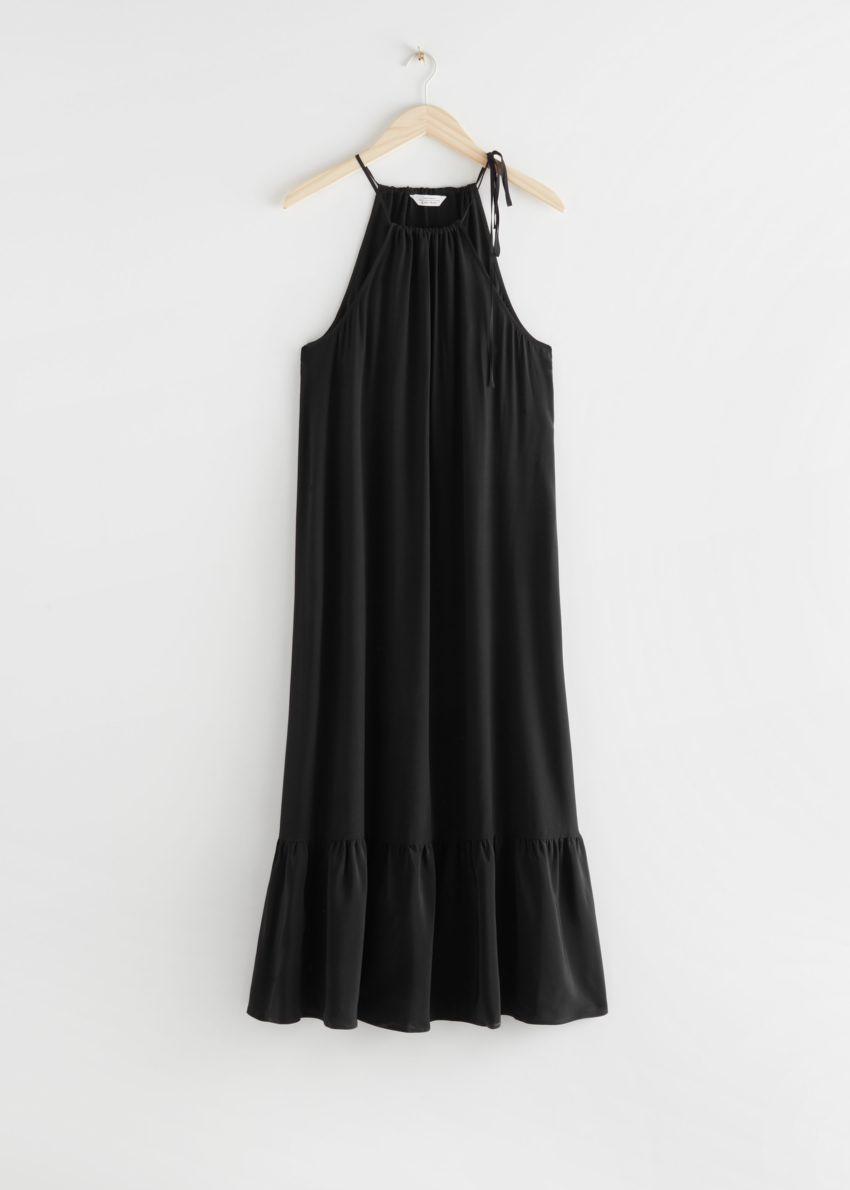 앤아더스토리즈 홀터넥 A라인 미디 드레스의 블랙컬러 Product입니다.