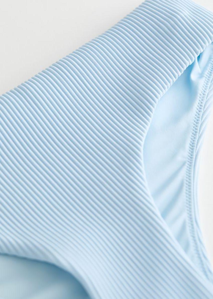 앤아더스토리즈 립 비키니 핫팬츠의 라이트 블루컬러 Product입니다.