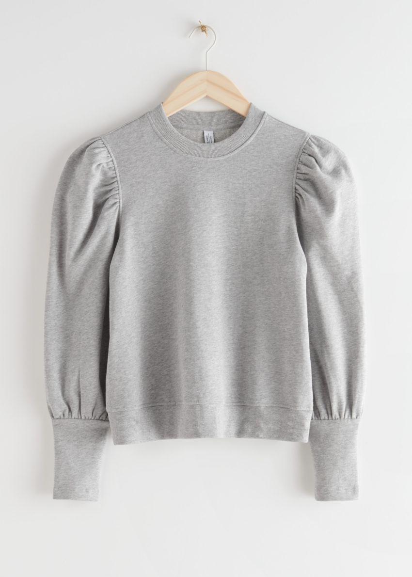 앤아더스토리즈 퍼프 슬리브 코튼 스웨트셔츠의 그레이 멜란지컬러 Product입니다.