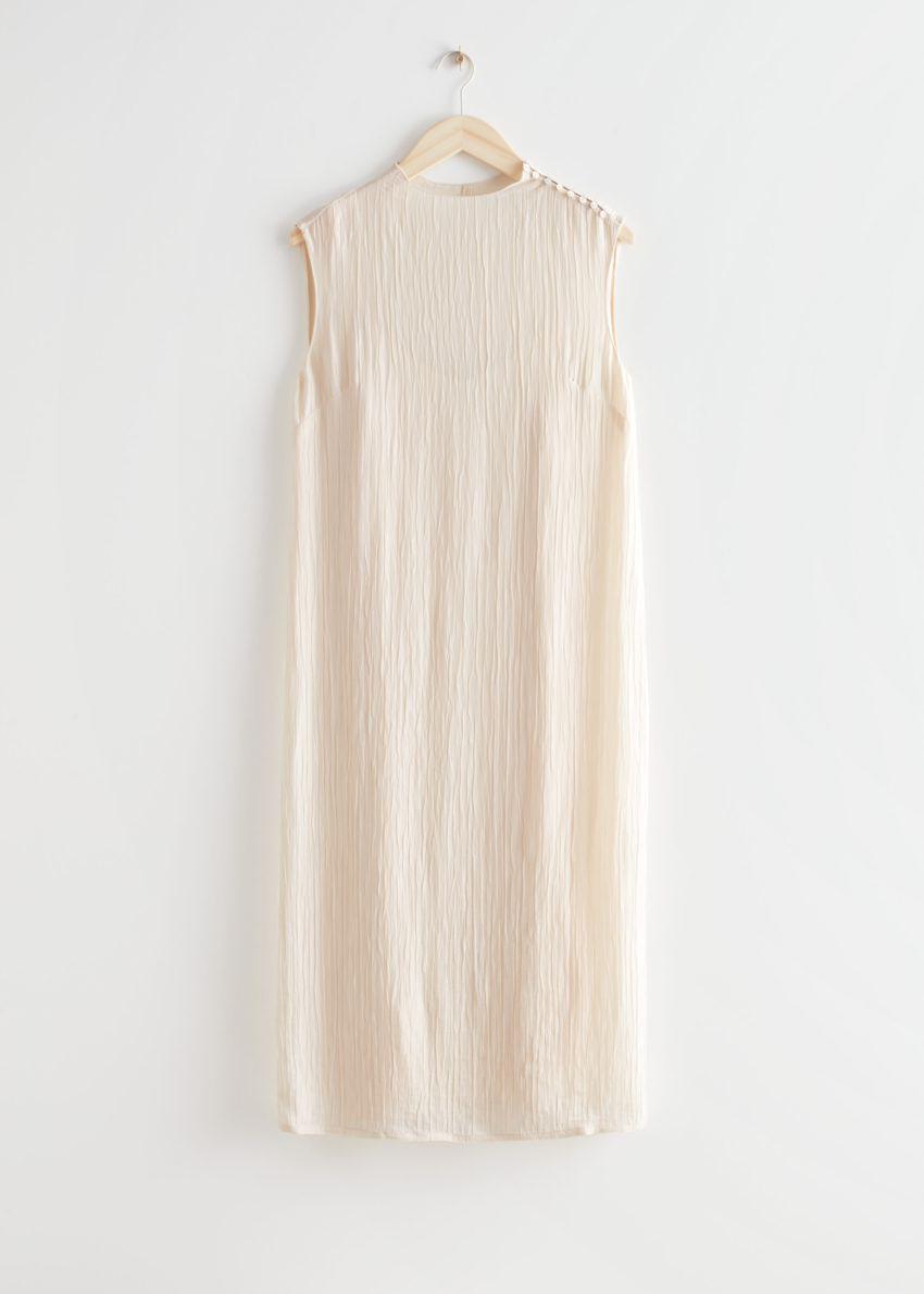 앤아더스토리즈 크링클 모크 넥 미디 드레스의 크림컬러 Product입니다.