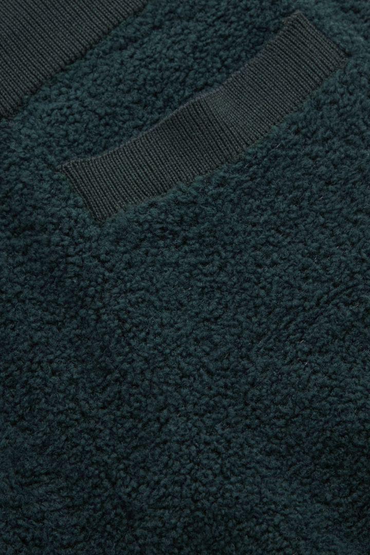 COS 메리노 울 테디 조거의 다크 그린컬러 Detail입니다.